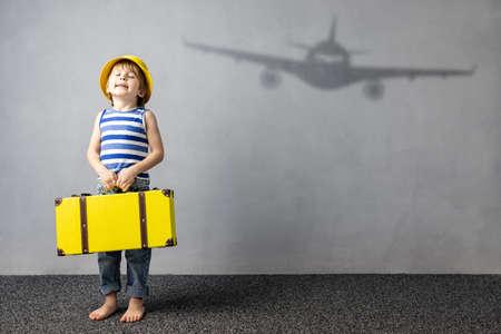 Photo pour Happy child dreaming about travel. Summer vacation concept - image libre de droit