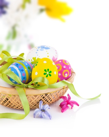 Photo for easter eggs in basket with bow isolated on white background - Royalty Free Image