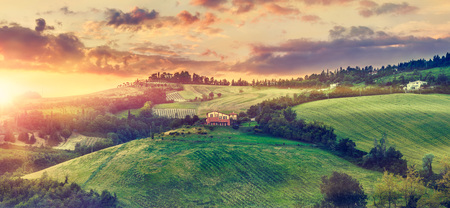 Picturesque sunset over green hills sunshine Italy dramatic sky cloud panorama landscape. Bologna. Tuscany.