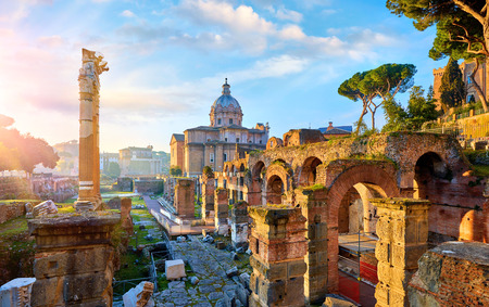 Foto de Roman Forum in Rome, Italy. Antique structures with columns and archs. Wrecks of ancient italian roman town. - Imagen libre de derechos