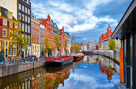 Photo pour Channel in Amsterdam Netherlands houses river Amstel landmark old european city spring landscape. - image libre de droit