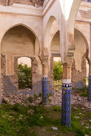 Photo pour Yard of a ruin of an abandoned building. Decorative columns with traditional painted tiles with geometrical motive.  Dar Caid Hadji (used also Hajji), south of Safi, Morocco. - image libre de droit