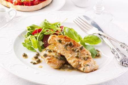 chicken piccata with arugula salad