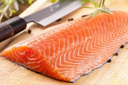 Salmon filet on a wooden board