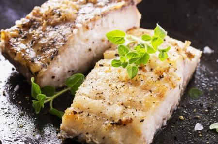 Foto de fish fillet fried in the pan - Imagen libre de derechos