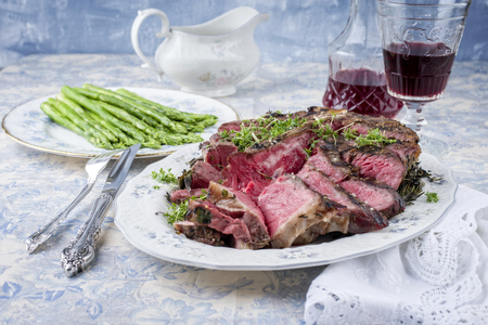 Sliced ??Porterhouse Steak with Green Asparagus on Plate