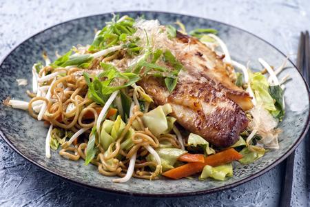 Fish Teriyaki with Yakisoba Noodles and Vegetable on Plate