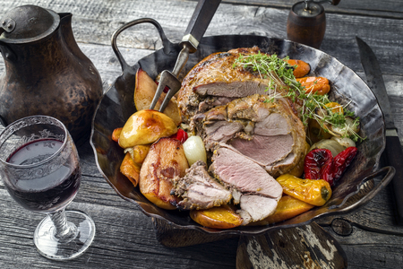 Leg of Lamb with Vegetable and Fruit in Iron Pan