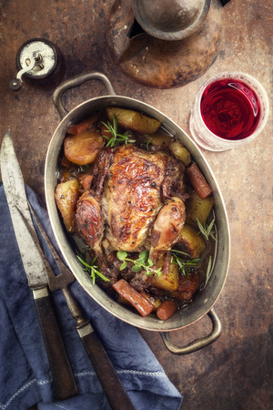 Coq au Vin with Vegetable in Burgundy sauce as a top view in a Casserole
