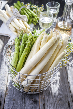 Row of green and white asparagus as close-up in a basket