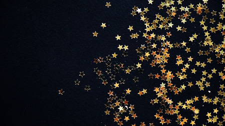 Photo for Golden Christmas stars on black background. - Royalty Free Image