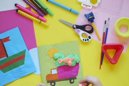 Photo for School supplies, stationery on yellow background - space for caption. Child ready to draw with pencils and make application of colored paper. Top view. - Royalty Free Image