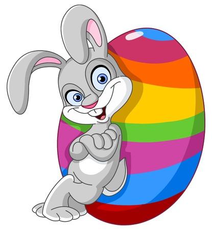 Ilustración de Happy bunny leaned against a big Easter egg - Imagen libre de derechos