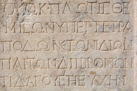Foto de ancient greek written stone tablet. ancient greek alphabet - Imagen libre de derechos