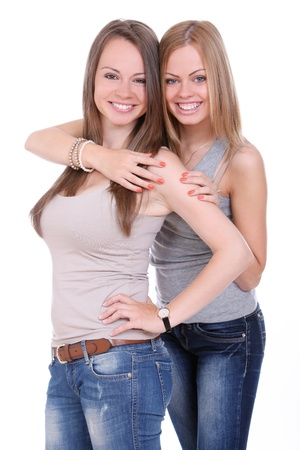 Two beautiful sisters over white background