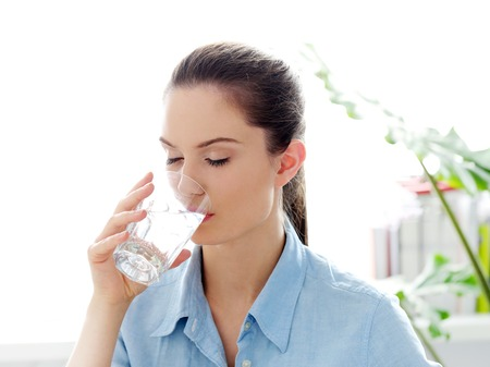 Morning  Attractive woman with glass of water