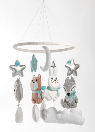 Photo pour Colorful and eco-friendly children's mobile from felt for children. It consists of bear, fox, owl, rabbit, mountain, stars, clouds and balloons toys. Handmade on gray background. - image libre de droit