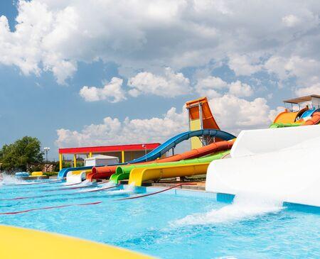 Photo pour Outdoor water park. Multi-colored slides and pools. No people. - image libre de droit