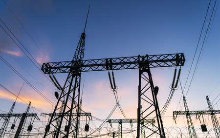 Photo pour High-voltage power lines at sunset or sunrise. High voltage electric transmission tower. - image libre de droit