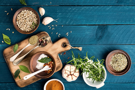 Foto de culinary background with spices on wooden table - Imagen libre de derechos