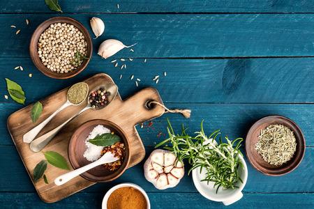 Foto de culinary background with spices on wooden table - Imagen libre de derechos