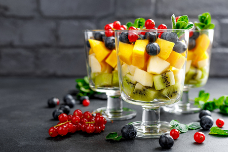 Photo for Fresh salad with fruits and berries in glass - Royalty Free Image