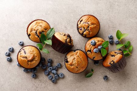 Foto de Blueberry muffins with fresh berries, top view - Imagen libre de derechos