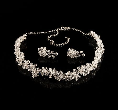 Diamond necklace and earrings on a black background