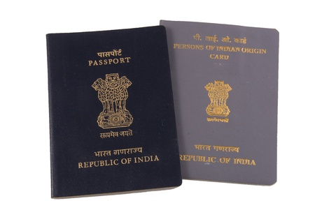 Indian Passport and Dual Citizenship card - isolated