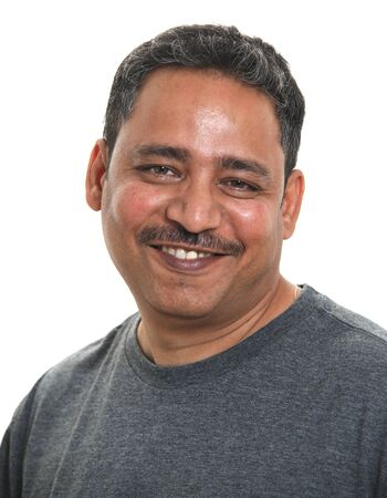 Photo for A smiling Indian man in a studio against a white background - Royalty Free Image