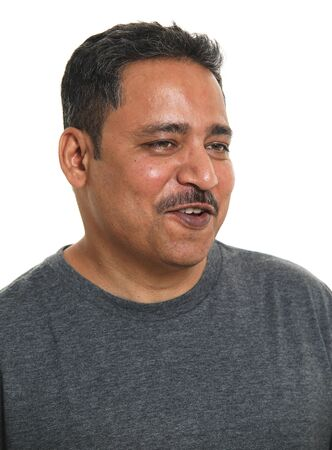Photo pour A smiling Indian man in a studio against a white background - looking away - image libre de droit