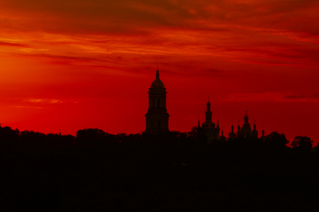 siluette to Lavra monastery, Kiev landmark. Red sunset