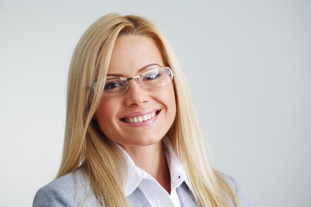 business woman in glasses on gray backgroundの写真素材