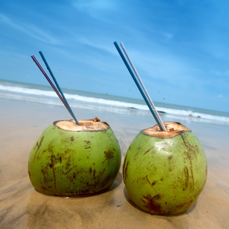 coconut cocktail on beach sand