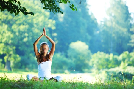 Photo for yoga woman on green grass in lotus pose - Royalty Free Image