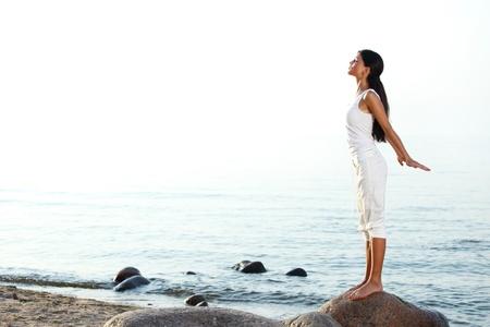 meditation on ocean sand beach