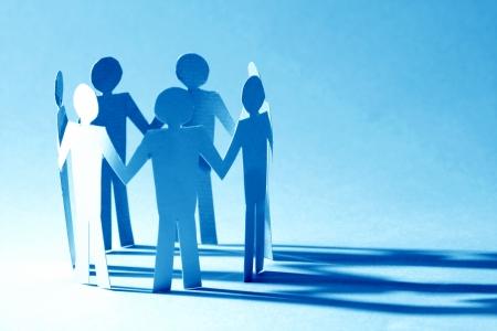 Photo pour paper team linked together partnership concept - image libre de droit