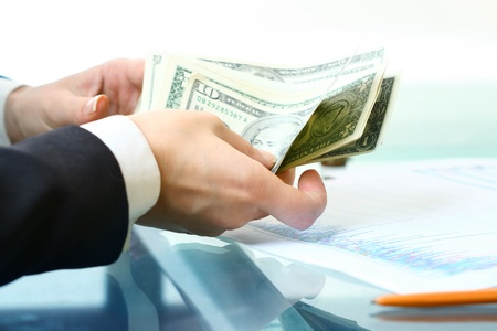 Photo pour hands counting dollar money on white background - image libre de droit