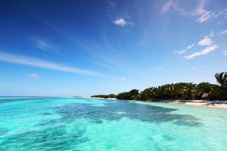 tropical island in blue sea