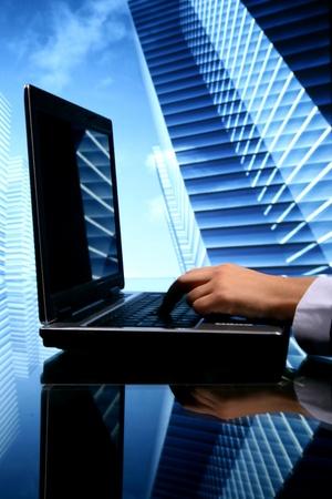 Foto de realtor cyber sales scrapers on background - Imagen libre de derechos