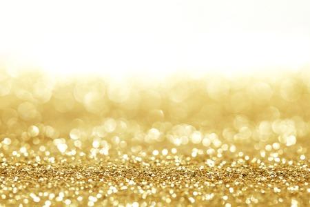 Golden shiny glitter holiday celebration background with white copy space