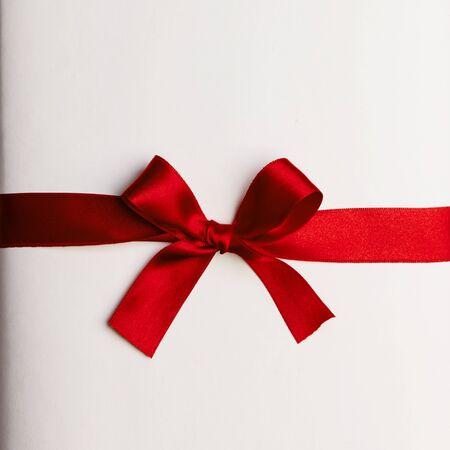 Photo pour Red gift bow on white background - image libre de droit