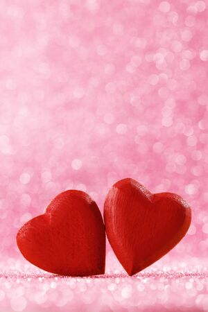 Photo pour Two handmade wooden red hearts on beautiful bokeh background. Vintage style. Love Valentine's Day concept. - image libre de droit
