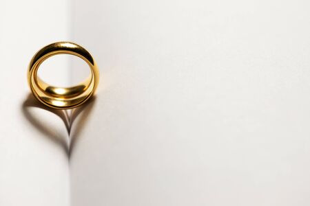 Photo pour Two golden wedding rings on blank book pages background with copy space for text - image libre de droit