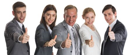 Foto de Successful smiling business team with thumbs up isolated over a white background - Imagen libre de derechos