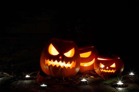 Foto de Halloween pumpkin head lanterns and burning candles on black background - Imagen libre de derechos