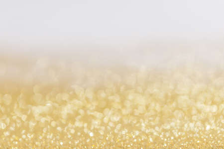 Photo for Abstract golden glitter background of shiny lights bokeh Christmas New year celebration luxury party - Royalty Free Image