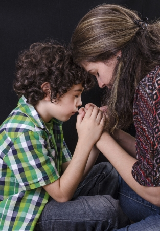 Mother and son praying and praising God