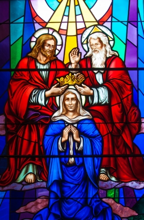 Colorful and beautiful stained glass in a Catholic Church. Different religious meanings and