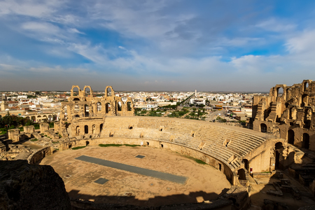 Photo pour El Jem amphitheater in Tunisia on a sunny day with cloudy sky in a background. - image libre de droit